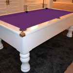 low quality white and purple pool table